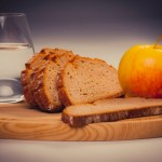 water glass, apple and bread